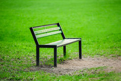 Lonely broken bench in the park Royalty Free Stock Photos