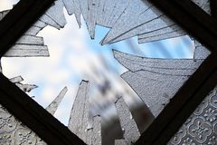 Lonely broken window. Broken window, trilogy on the window and sad concept royalty free stock photo