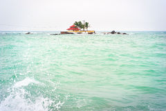 Lonely building in the ocean Stock Photo