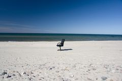 Lonely business chair on beach Stock Images