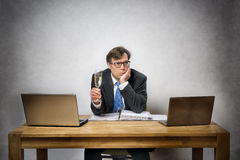 Lonely business man with champagne glass Royalty Free Stock Photography