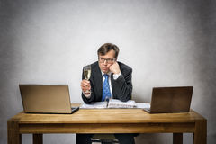 Lonely business man with champagne glass Stock Photos