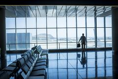 Free Lonely Business Man Travel And Wait At The Airport Gate - Concept Of Delay And Cancel Filght Problem And Passenger Rights - People Stock Photography - 183615482