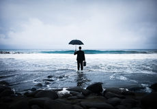 Lonely Businessman Alone in the Beach Stock Photos