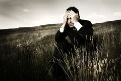 Lonely businessman depressed about life Stock Photography
