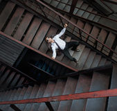 Lonely businessman on metal staircases Royalty Free Stock Photo