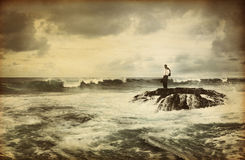Lonely Businessman Standing by the Seaside Royalty Free Stock Images