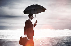 Lonely Businessman Walking by the Beach Concept.  stock photography