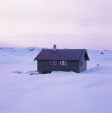 Lonely cabin in winter mountain Stock Photo