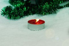 Lonely candle Winter weather. Candle burning in winter. The holiday is coming royalty free stock images