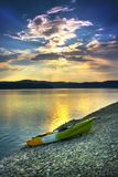 Lonely canoe at sunset Royalty Free Stock Images