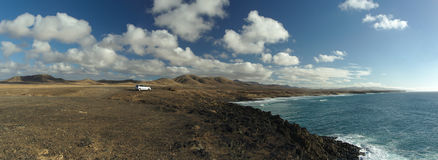 Lonely car at the coastline. Panorama of coastline with lonely car stock photo
