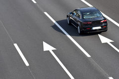 Lonely car in empty highway. Landscape orientation royalty free stock photography