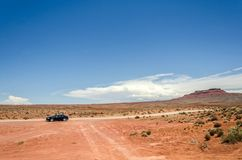 Lonely car in the red sand desert. In the US Southwest royalty free stock photos