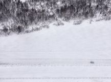 Lonely car on snowy road. Russia, the extreme north, winter, snow. lonely car on snowy road stock photography