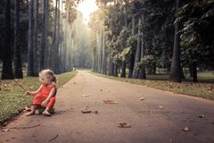 Lonely carefree child girl playing on road in park alone concept loneliness carefree childhood lifestyle royalty free stock photos