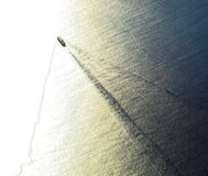 Lonely Cargo. Making his way on the ocean Royalty Free Stock Photography