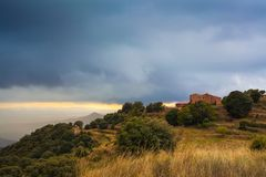 Lonely catalan farmerhouse under thunderstorm stock image