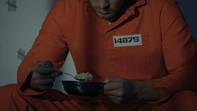 Lonely Caucasian prisoner refusing disgusting meal, need normal food, close-up. Stock footage stock video