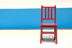 Lonely chair in a bright background. This chair is isolated on blue and white Stock Photos