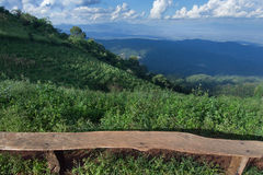 Lonely chair with grass, mountain and cloudy sky view of Chiangm Stock Images
