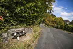 Lonely chair and road. In European Royalty Free Stock Photography