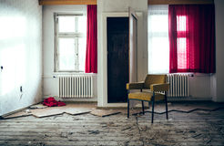 Lonely chair in the room Stock Photos