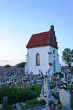 Lonely chapel at dusk. Lonely chapel at rural graveyard in village Tykocin Poland Royalty Free Stock Photos
