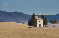 Lonely chapel in the valley of Orcia Stock Photos