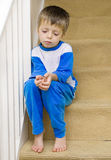 Lonely Child. Sits on the stairs Stock Image