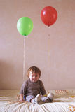 Lonely child with balloons Royalty Free Stock Photo