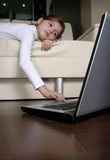 Lonely child in home. Playing with laptop Stock Photography