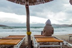Lonely child in stormy weather at night in the beach royalty free stock photography