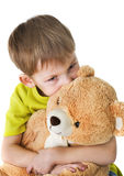 Lonely child with teddy bear Royalty Free Stock Image