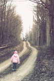 Lonely children on a forest road Stock Photos