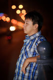 Lonely chinese young man. In the street at night Royalty Free Stock Image