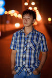 Lonely chinese young man. In the street at night Royalty Free Stock Photos