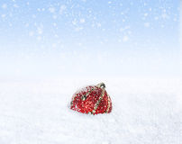 Lonely Christmas Ball in the Snow Stock Photo