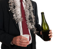Lonely this Christmas - business man alone. Tinsel and wine but not much of an office party! Maybe in need of love Stock Photography