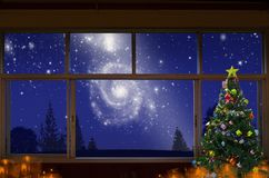 Lonely Christmas with milky way sky at night. Lonely Christmas in the house with beautiful milky way sky at night stock image