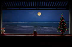 Lonely Christmas night beside the beach. Lonely Christmas night of house in resort beside the beach stock image