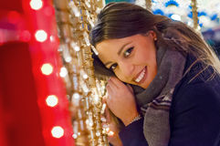 Lonely Christmas woman on the winter street at night. Festive br Royalty Free Stock Photo