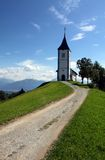 Lonely church on a hill. Stone path to the church stock images