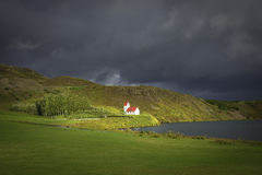 Lonely Church illuminated by sun at Iceland, summer time Stock Photos