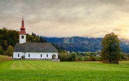 Lonely church in the mountain near the Lake Bohinj Stock Photo