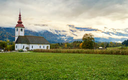 Lonely church in the mountain near the Lake Bohinj Stock Photos
