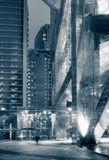 Lonely city night. With businessman walking blurred outside of modern office building royalty free stock photos