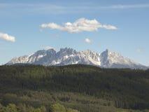 Lonely Cloud Above Mountain Ridge stock photos