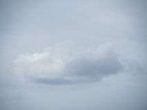 Lonely cloud before a cloudy sky Stock Photography