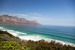 Lonely coast and mountains Stock Images